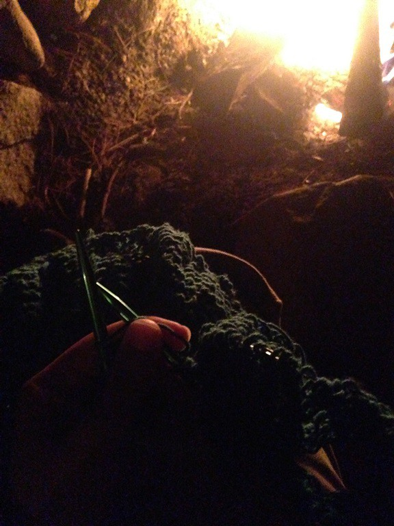 Knitting by a campfire