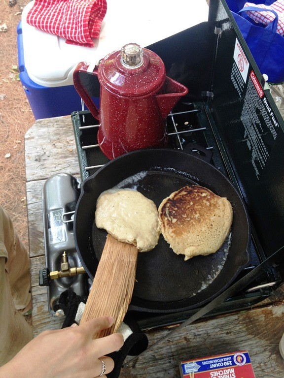 Wooden stick flipping pancakes