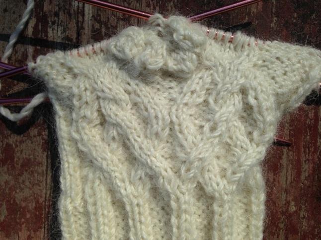 Bobble detail on cabled fingerless gloves